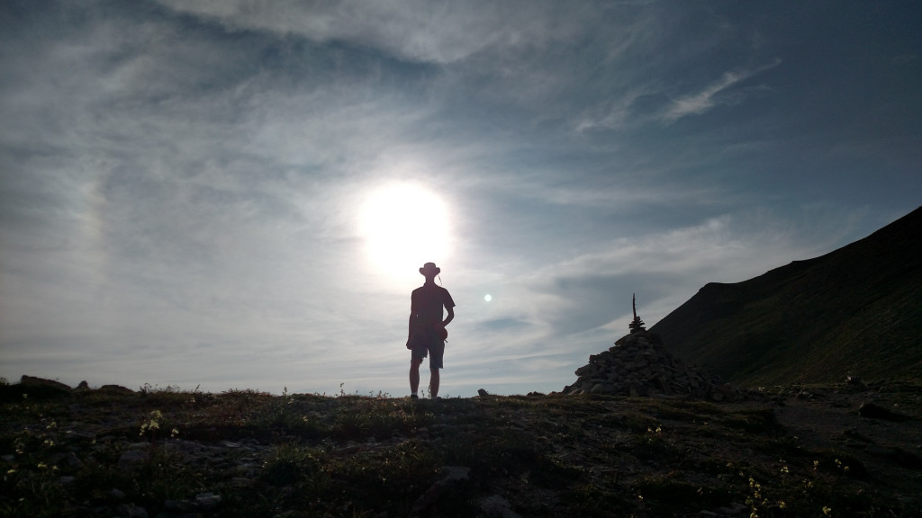 Silhouette of Christian at the top of Sacajawea Pass.