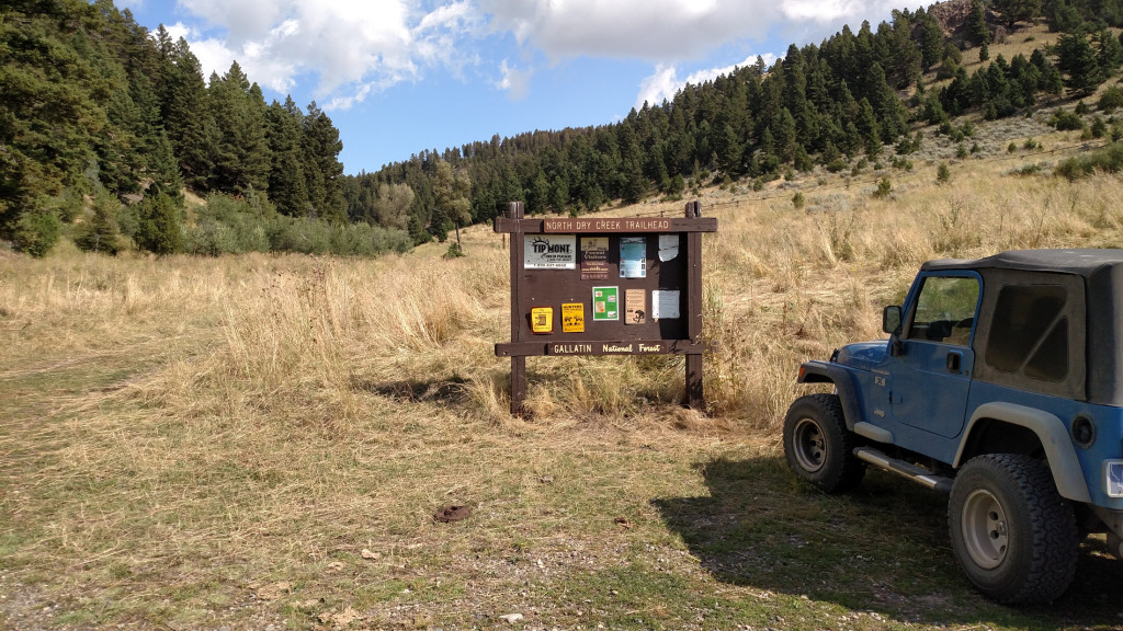 The road to the left of the sign leads to a secondary trailhead about 2.5 miles in. Looks like it probably doesn't get much use and requires a high clearance vehicle.