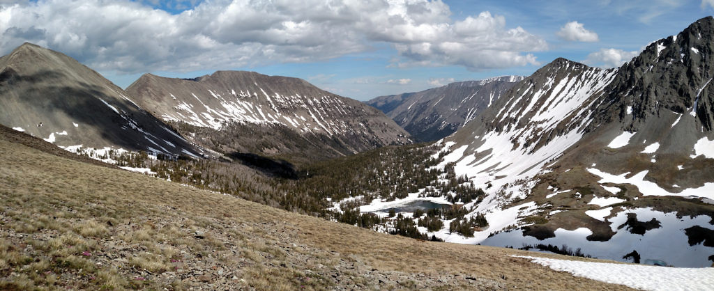 Looking east from the saddle. The Sunlight Lake Trail follows the valley.