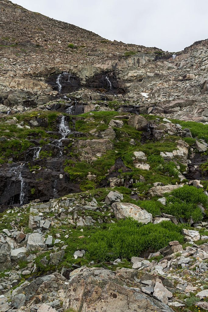 Beautiful waterfalls cascading from the lake above.