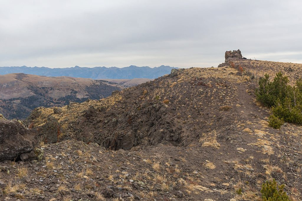 Looking east towards the summit of Black Butte which is marked by the large cairn. Madison Range in the distance.