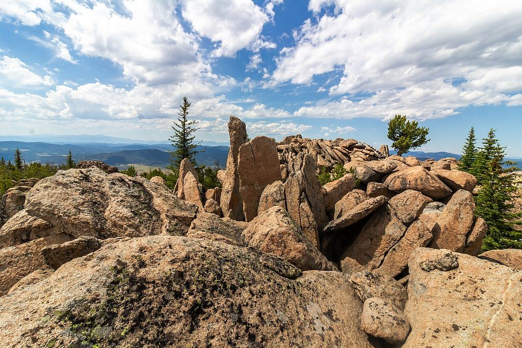 The summit of Haystack Mountain is mostly just heaping pile of granite boulders. The true summit is either the narrow boulder sticking up in the center left or the wider boulder behind it to the right. A fire lookout use to exist on the summit but little evidence of it remains.