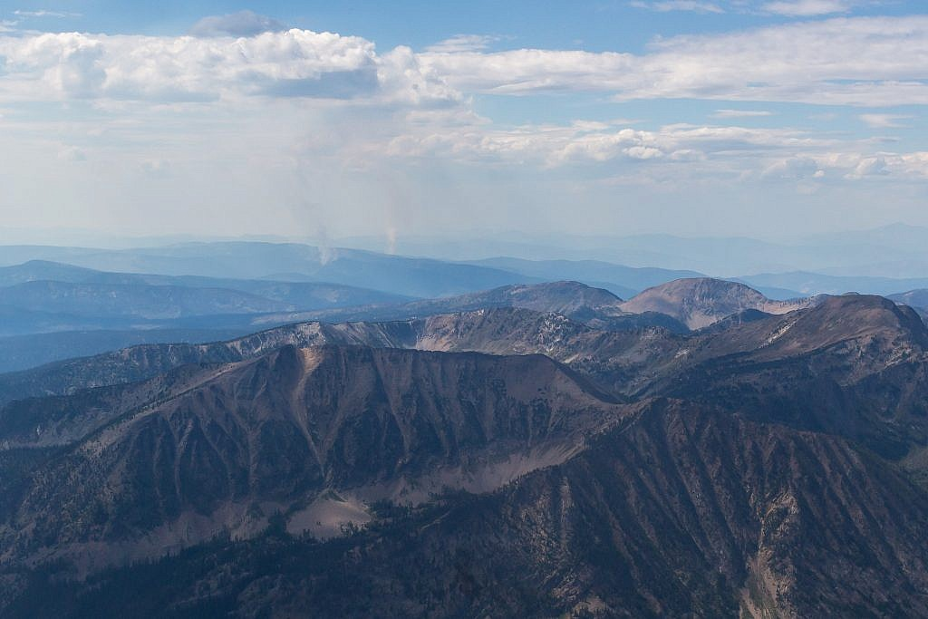 Closeup shot of what appears to be some small forest fires burning in the distance.