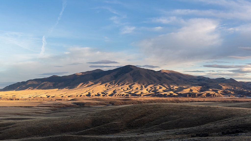 The southern end of the McCartney Mountain Range. Bell Peak is the prominent point in the center and McCartney Mountain is just behind it on the left.
