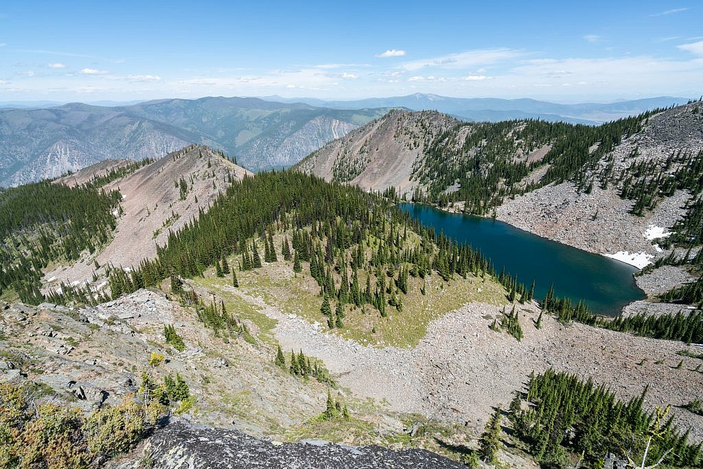 Tuffy's Lake lookout. I bushwhacked up to this point from the junction but I'm fairly confident the left fork will take you down to the lake which looks like a great backpacking destination. Baldy Mountain way off in the distance.