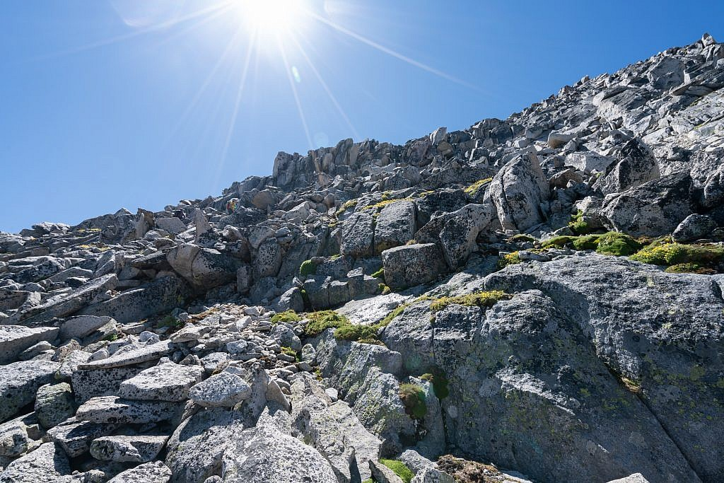 After about 1,000′ of vertical the terrain transitions into a straight-up boulder field. The boulders are large and stable which makes the ascent quite fun.